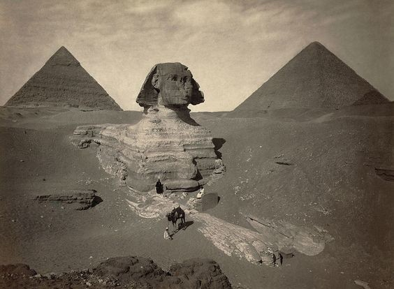 A rare, ancient photograph of the Sphinx before it was completely excavated.