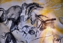 Aurignacian cave paintings, Chauvet Cave. Image Credit: Wikimedia Commons.