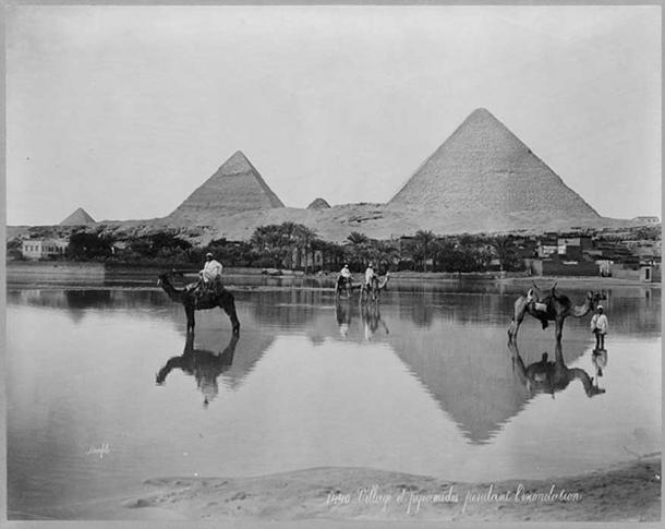 A Village and the pyramids during the flood-time, circa 1890 (Public Domain).