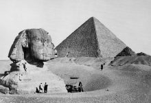 The Great Sphinx with the Pyramid of Pharaoh Cheops in the background. 1877 photo by French photographer Henri Bechard. Shutterstock.