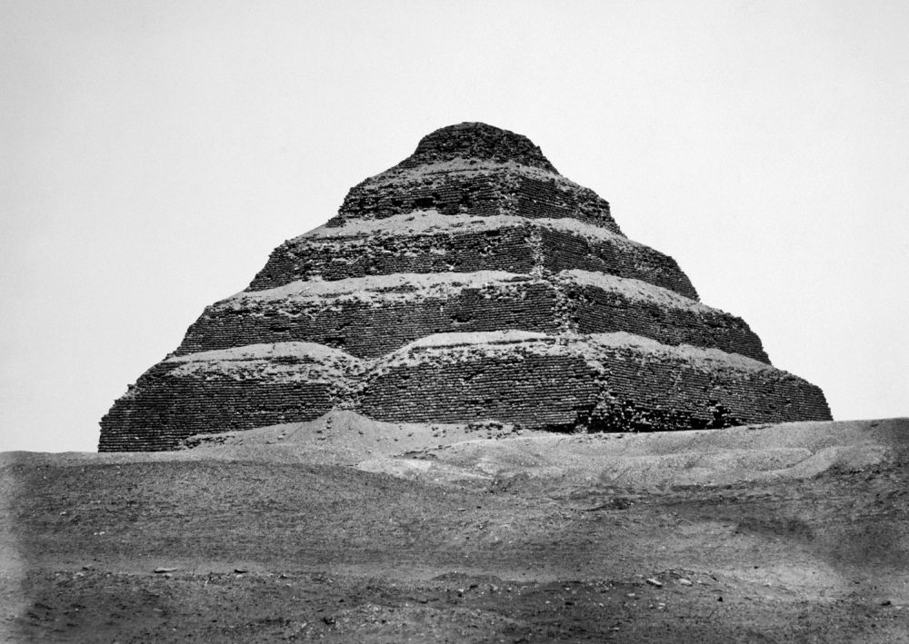 The Step Pyramid of King Zoser, III Dynasty, Old Kingdom, ca. 2590 B.C., photograph by Antoine Beato ca. 1880. Shutterstock.