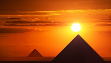 An image of pyramids and the sunset. Shutterstock.