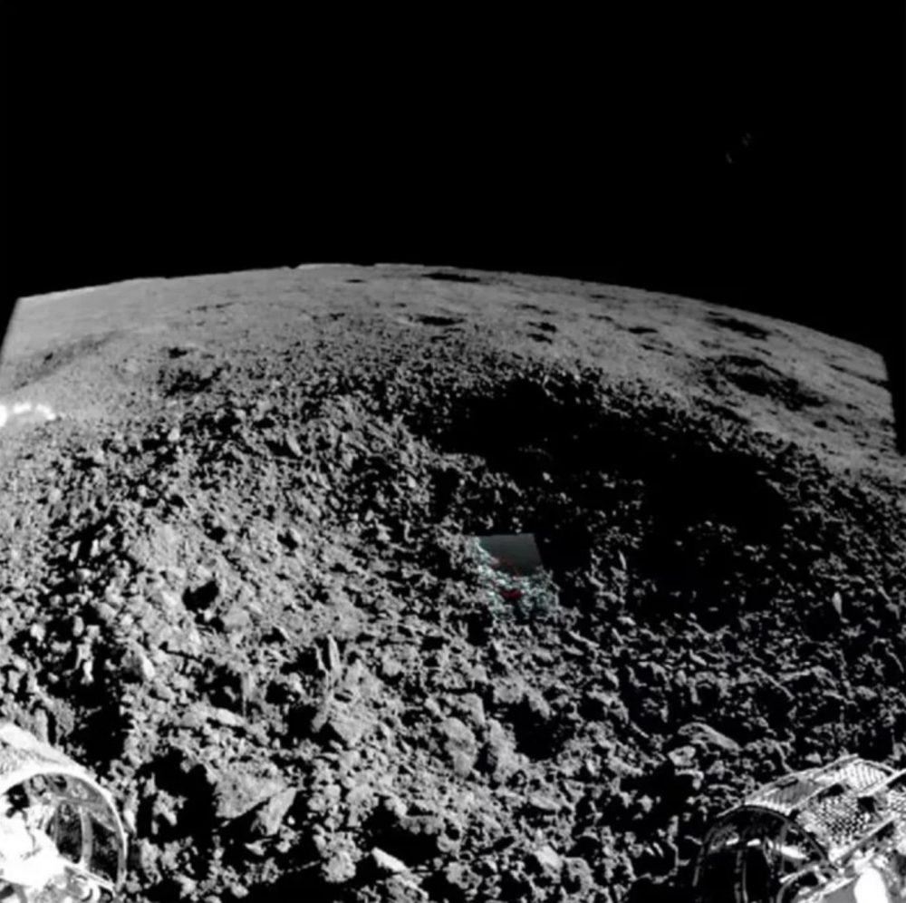 China's Yutu-2 moon rover captured this image from the edge of the small crater where it found a mysterious, gel-like material. Image Credit: China Lunar Exploration Project.