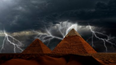 Pyramids and Storm in the background. Shutterstock.