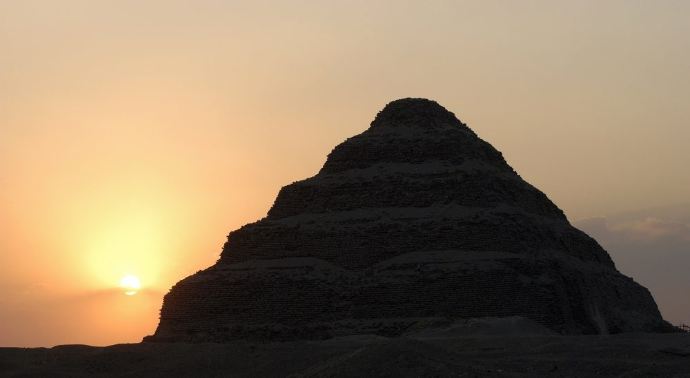 The Step Pyramid of Saqqara and the Sun in the background. Shutterstock.