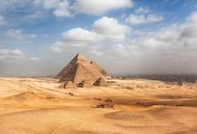A view of the Giza Pyramid Complex with the city of Giza in the background. Shutterstock.