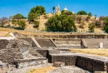 An image of the ruins of the Great Pyramid of Cholula with the Church of Our Lady of Remedies built on top of the pyramid. Shutterstock.