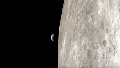 Apollo 13 view of the surface of the moon and Earth. Image Credit: NASA.