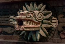 An ancient statue depicting the feathered serpent Quetzalcoatl. Shutterstock.