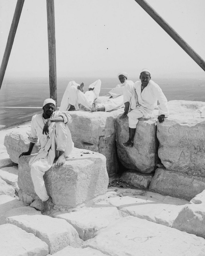 An image of people resting at the summit of the Great Pyramid of Giza. The image was taken circa 1900. Image Credit: Library of Congress.
