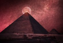 The Great Pyramid of Giza in front of a Full Moon. Shutterstock.