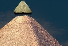 An image of the Great Pyramid of Giza and what its capstone may have looked like. Shutterstock.