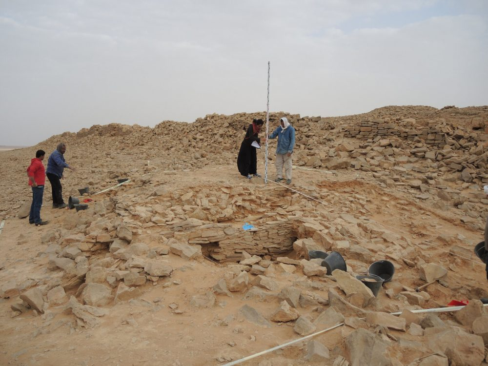 An image of the stone platform during excavation. Image Credit: MADAJ.