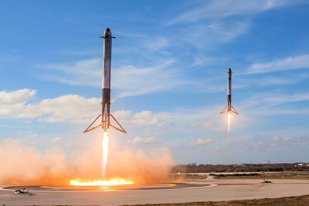 Falcon Heavy's two side-boosters landing at LZ-1 and LZ-2.