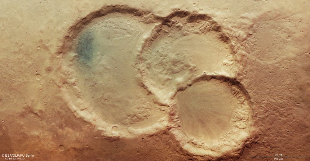 An image of a triple crater on Mars. Image Credit: ESA / DLR / FU Berlin / CC BY-SA 3.0 IGO.