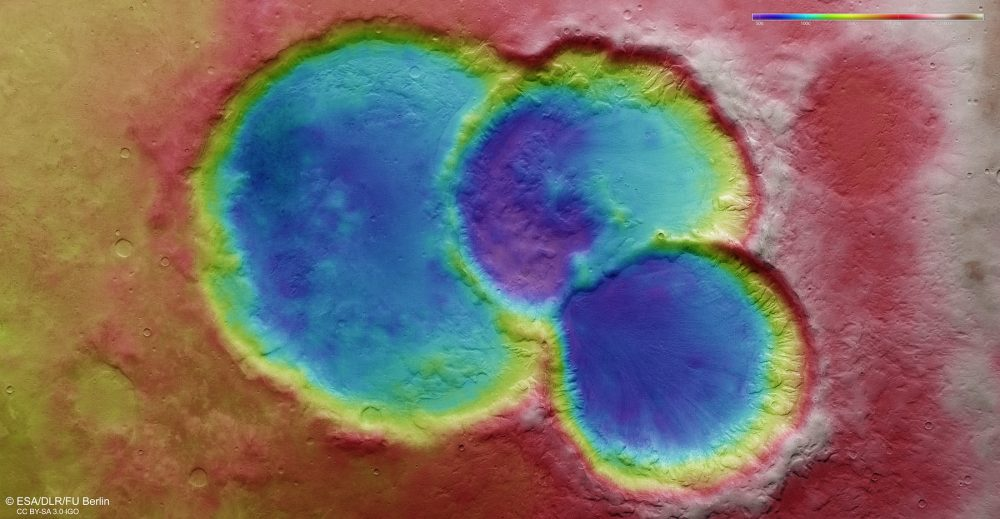 This image shows a topographic view of the triple crater spotted by Mars Express on the surface of Mars. Image Credit: ESA / DLR / FU Berlin / CC BY-SA 3.0 IGO.