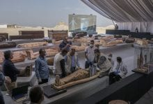 The exhibition of the latest discovery of ancient Egyptian sarcophagi and statuettes. Here, you can see the moment of the X-Ray scan performed in front of the guests. Credit: Associated Press
