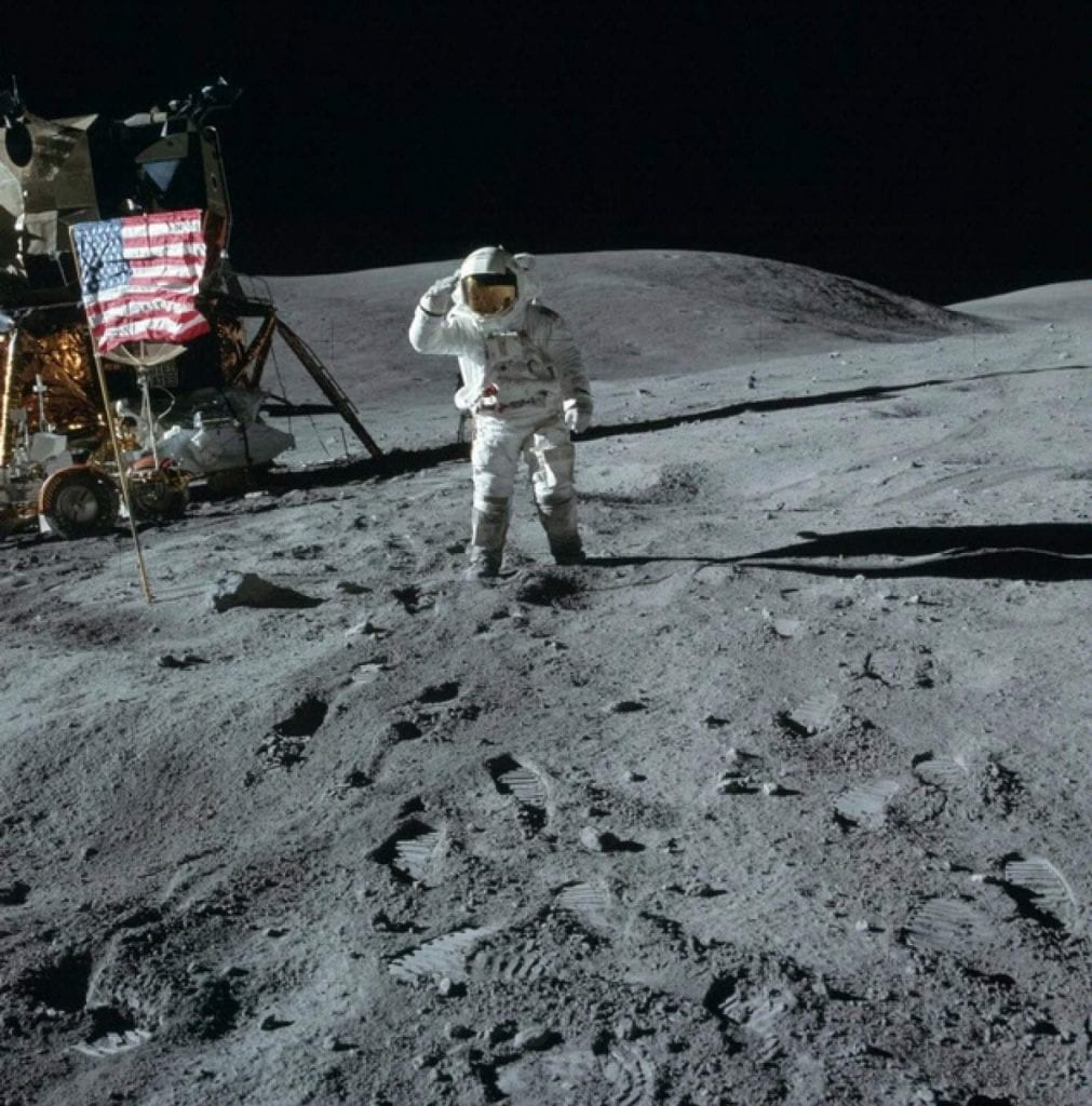 Lunar Module Pilot Charles Duke from Apollo 16 as he salutes the American flag. Credit: Smithsonian National Air and Space Museum / NASA