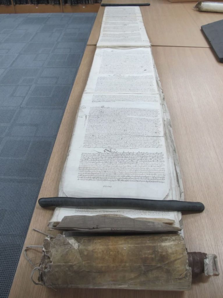 A four-meter-long scroll stretched out on a table at The National Archives in the United Kingdom. Image Credit: The National Archives, UK
