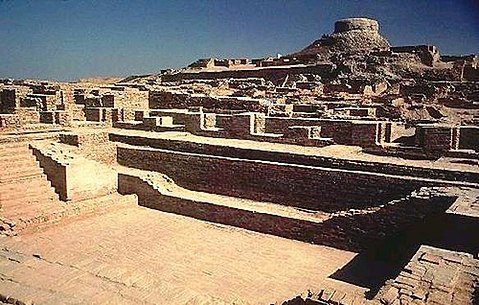 Excavated ruins of Mohenjo-daro, Sindh province, Pakistan, showing the Great Bath in the foreground. Mohenjo-daro, on the right bank of the Indus River, is a UNESCO World Heritage Site, the first site in South Asia to be so declared. Image Credit: Wikimedia Commons.