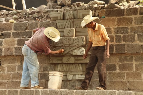 Workers performing restorative work at the archaeological site of Copan. Image Credit: Li Xinwei.