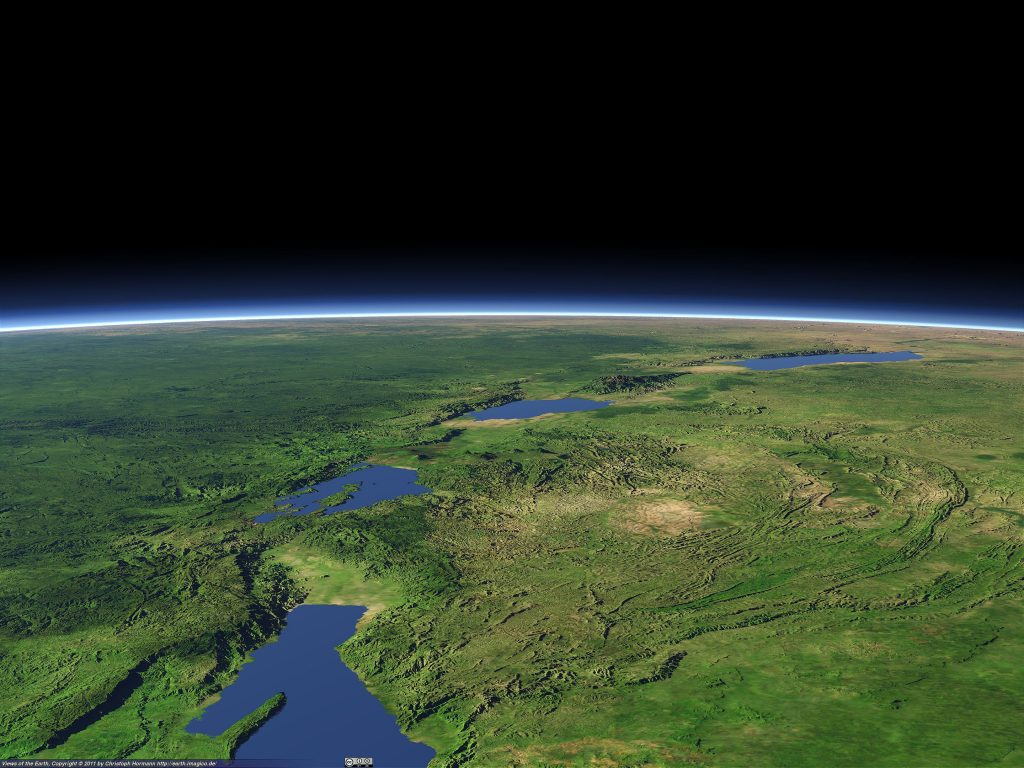 An artificial rendering of the Albertine Rift, which forms the western branch of the East African Rift. Visible features include (from background to foreground): Lake Albert, the Rwenzori Mountains, Lake Edward, the volcanic Virunga Mountains, Lake Kivu, and the northern part of Lake Tanganyika. Image Credit: Wikimedia Commons.