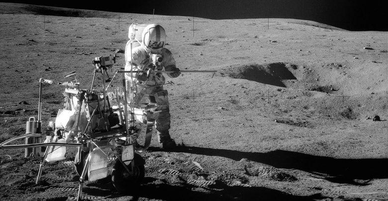 Apollo 14 Astronaut Alan B. Shepard Jr. assembles equipment on the lunar surface in February 1971. Credit: NASA.