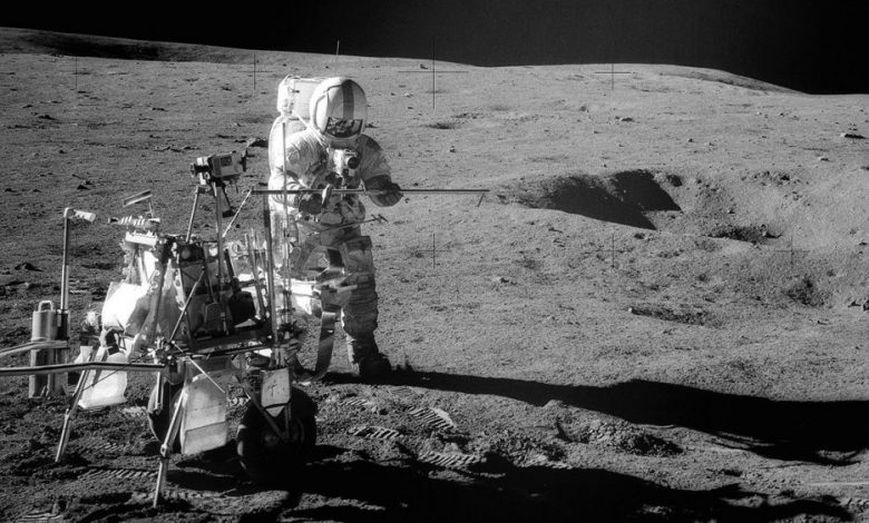 Apollo 14 Astronaut Alan B. Shepard Jr. assembles equipment on the lunar surface in February 1971. Credit: NASA.