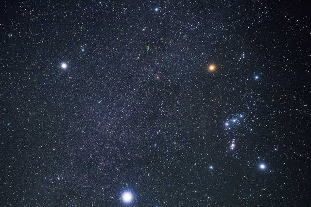 Procyon (top left), Betelgeuse (top right), and Sirius (bottom) form the Winter Triangle. Orion is to the right. Image Credit: Hubble European Space Agency / Akira Fujii.