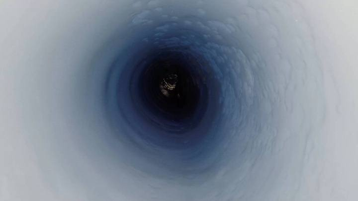 A view down the the borehole at about 3,500 feet (1,070 meters) below the ice. Image Credit: Kathy Kasic/salsa-antarctica.org.