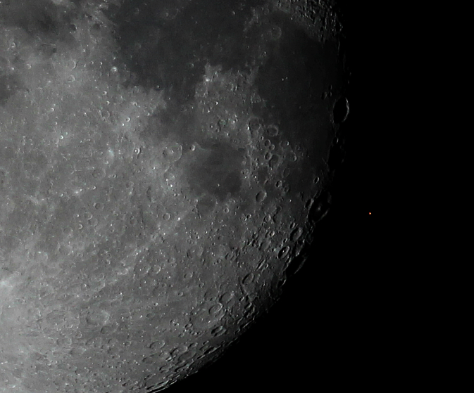 Occultation of Aldebaran by the Moon. Aldebaran is the red dot to the right, barely visible in the thumbnail. Image Credit: Christina Irakleous / Wikimedia Commons.
