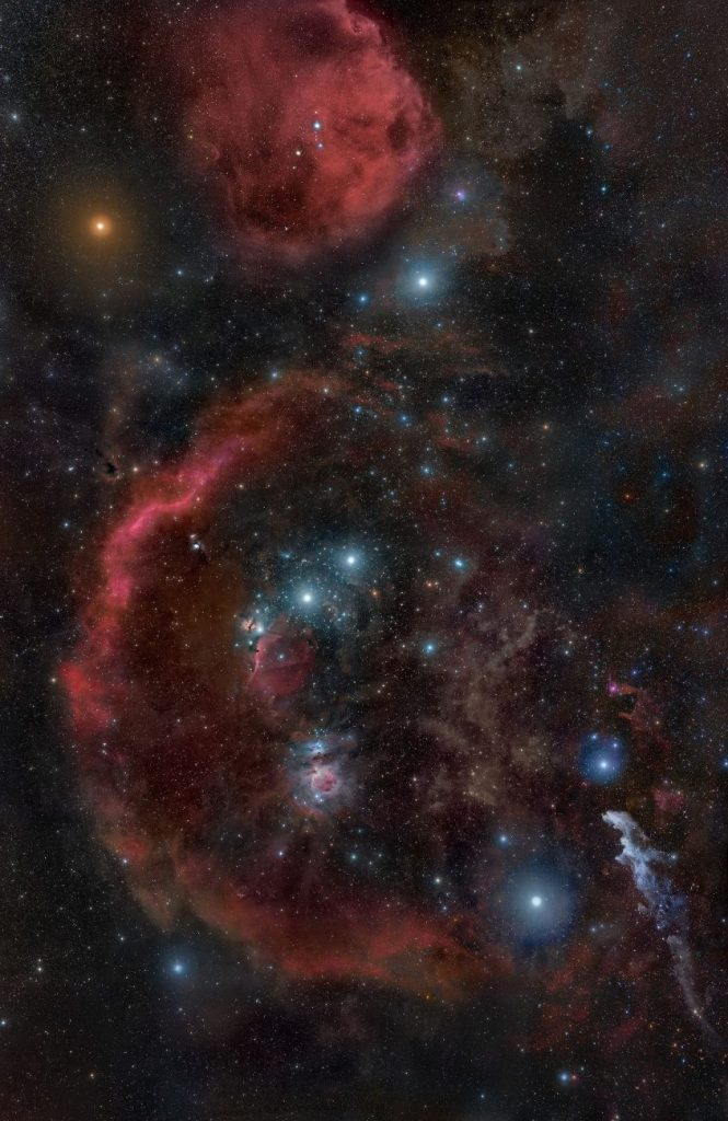 Image showing Betelgeuse and the dense nebulae of the Orion Molecular Cloud Complex. Image Credit: Rogelio Bernal Andreo / Wikimedia Commons.