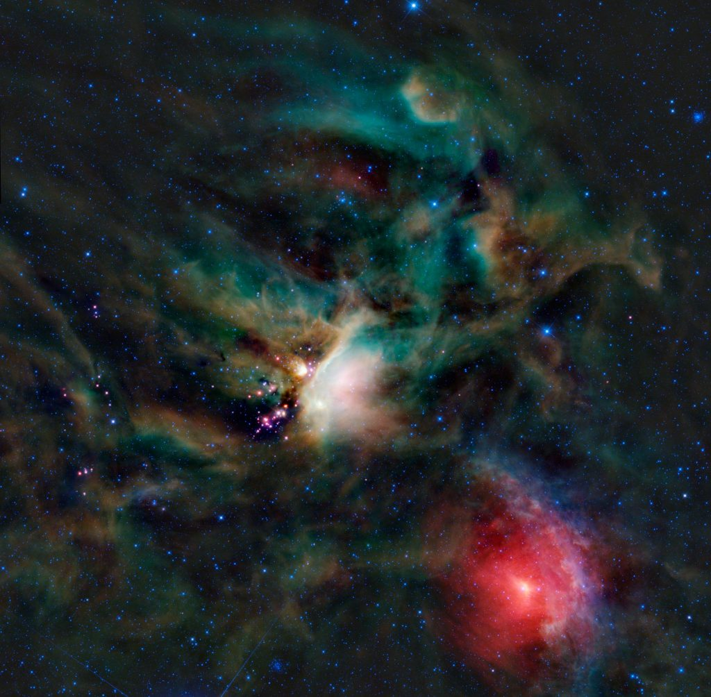 A rich collection of colourful astronomical objects is revealed in this picturesque image of the Rho Ophiuchi cloud complex from NASA's Wide-field Infrared Explorer, or WISE. Image Credit: Wikimedia Commons.