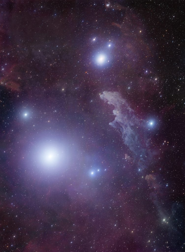 Rigel and reflection nebula IC 2118 in Eridanus. Rigel B is not visible in the glare of the main star. Image Credit: Robert Gendler - http://www.treasuresofthesouthernsky.org / Wikimedia Commons.