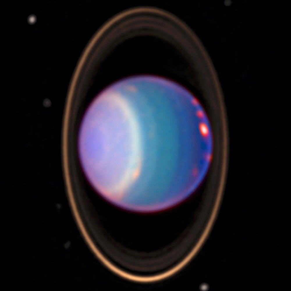 A 1998 false-colour near-infrared image of Uranus showing cloud bands, rings, and moons obtained by the Hubble Space Telescope's NICMOS camera. Image Credit: Wikimedia Commons.