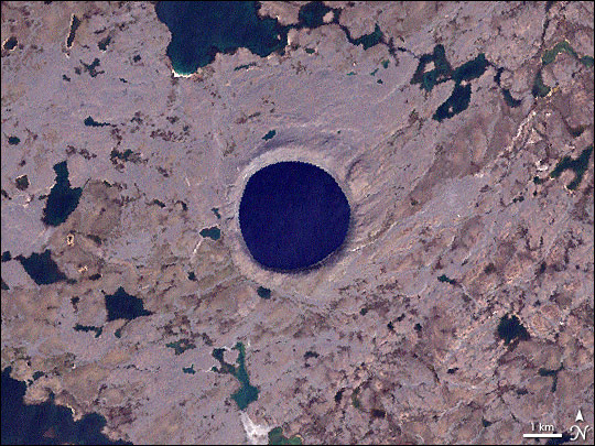 NASA's Landsat 7 satellite captured this image of Pingualuit Crater on August 17, 2002. In it, water appears blue, and land appears in varying shades of beige. With a diameter of 2.14 miles (3.44 kilometers), Pingualuit Crater holds a lake about 876 feet (267 meters) deep. Credits: NASA