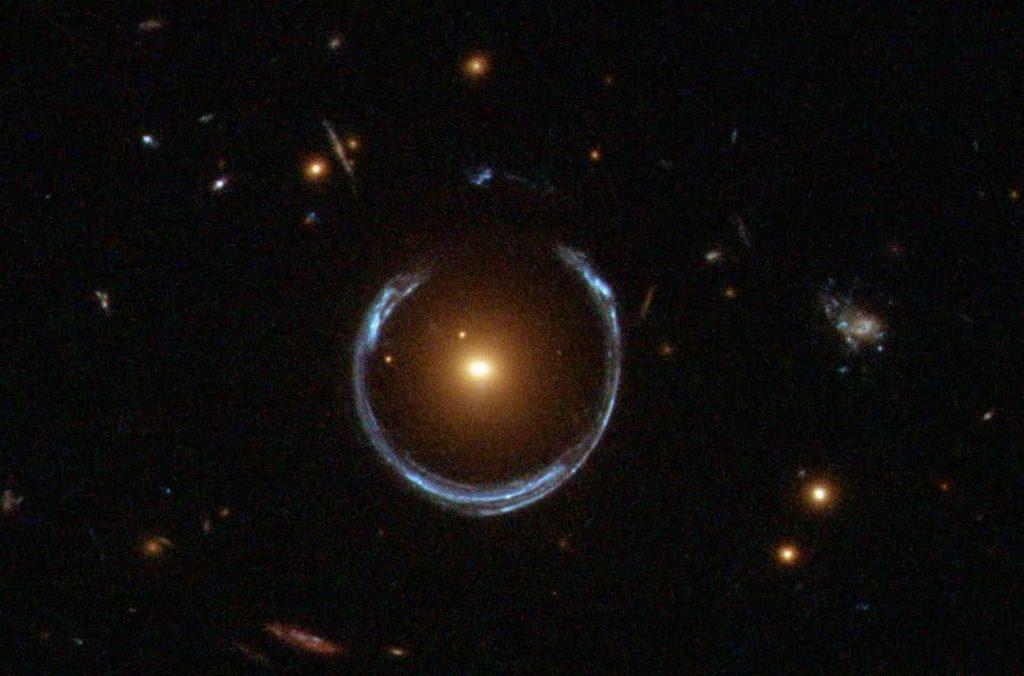 Gravitational lens mirage around a galaxy. Image Credit:NASA.