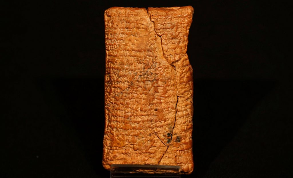 The clay tablet telling the story of the flood and the shape of the ark. Image Credit: AP Photo/Sang Tan.