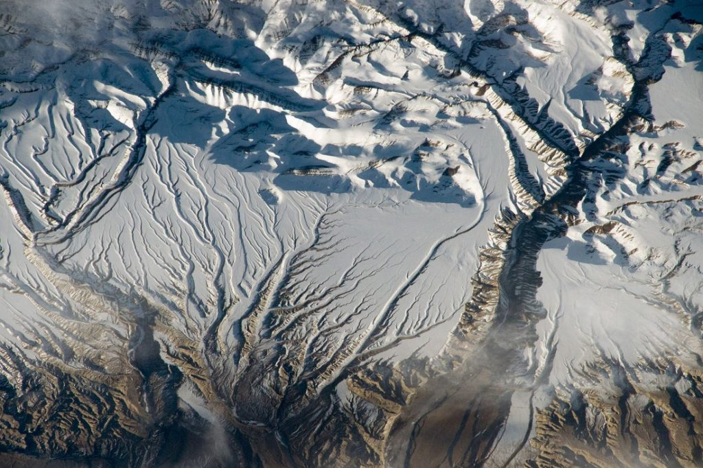 The Himalaya range, near the China–India border where peaks cast strong evening shadows on the snow. Image Credit: NASA.