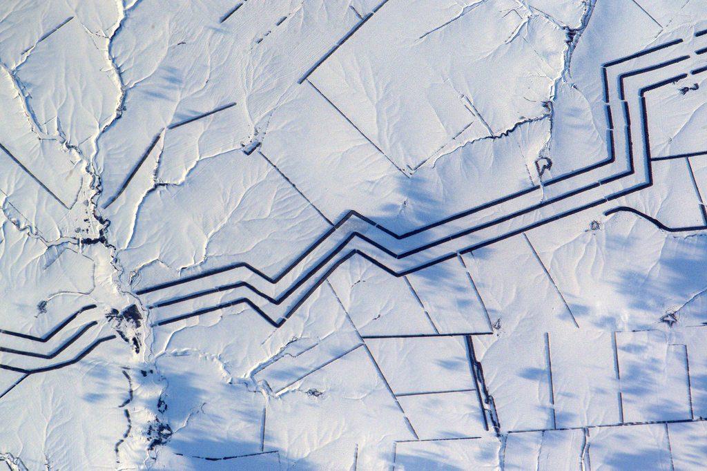 Minimalist snow art in Russia. Image Credit: NASA.