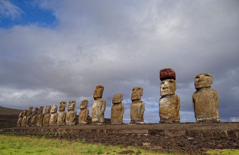 Ahu Tongariki. The second moai from the right has a pukao on its head. Image Credit: Wikimedia Commons.