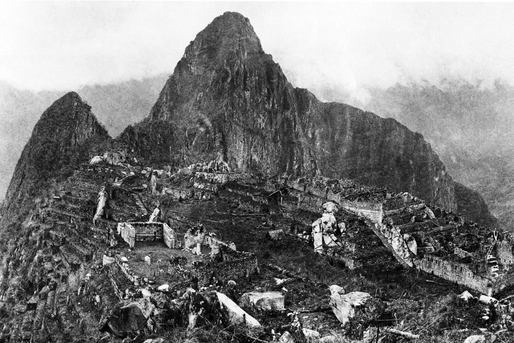 View of the city of Machu Picchu in 1912 showing the original ruins after major clearing and before modern reconstruction work began. Image Credit: Wikimedia Commons.
