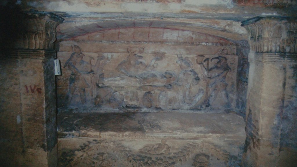 Sarcophagus with bas relief showing Egyptian gods and priests offering sacrifices. Image Credit: Wikimedia Commons.