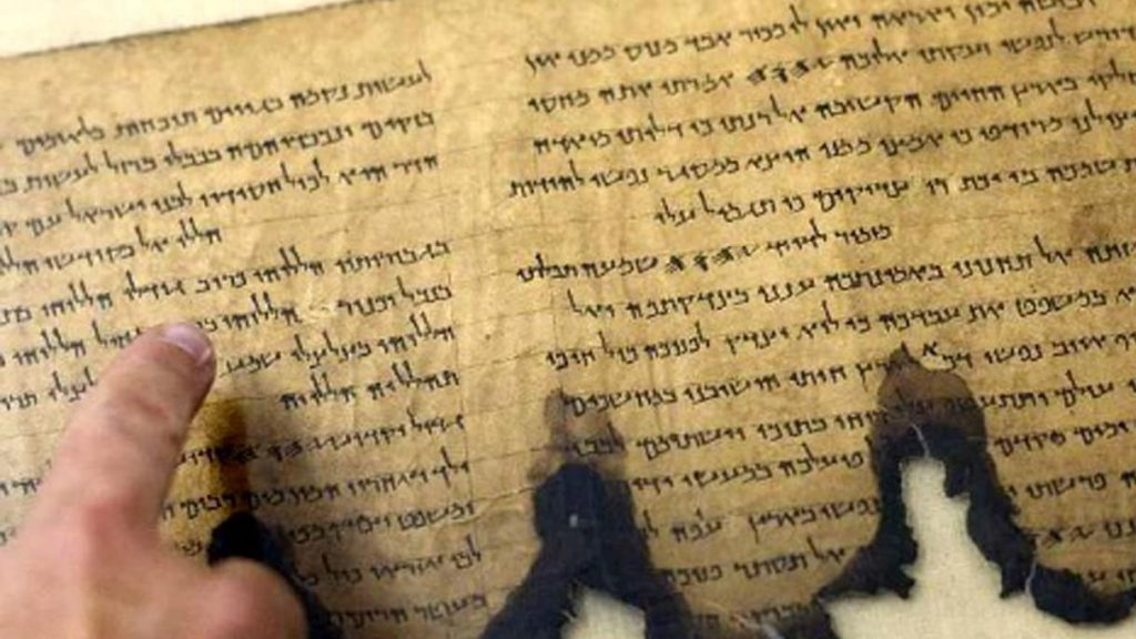 A fragment of the Dead Sea Scrolls at an Israel Antiquities Authority conservation laboratory in Jerusalem. Image Credit: AP.