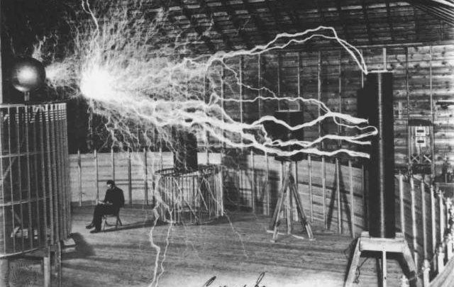 A photograph of Nikola Tesla in his Colorado Springs Laboratory. The image was captured in 1899.