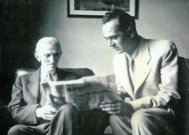 Nikola Tesla reading a newspaper.