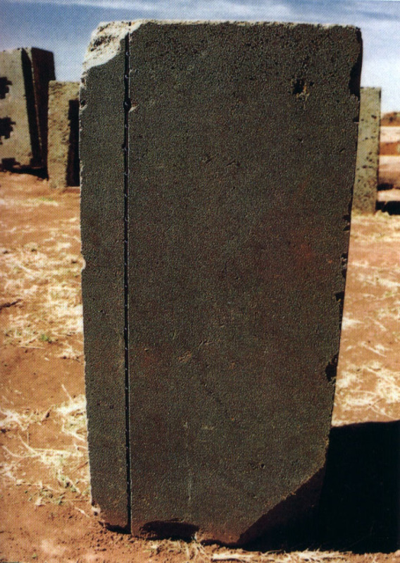 Detail of stone with precisely cut straight line and tooled holes within the line at Puma Punku. Image Credit: Wikimedia Commons.