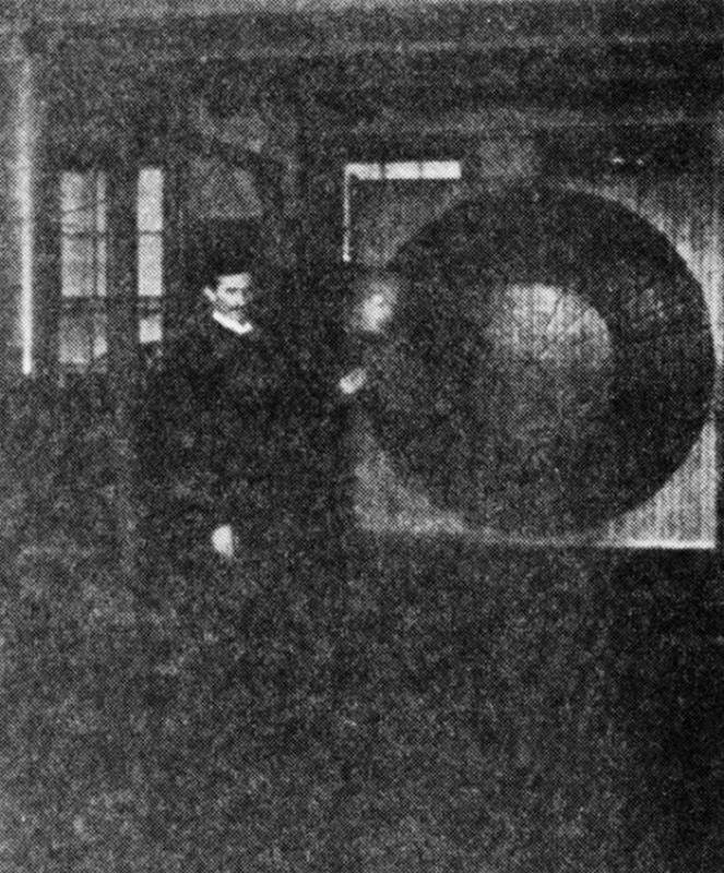 A rare photograph of Nikola Tesla performing experiments in his laboratory.