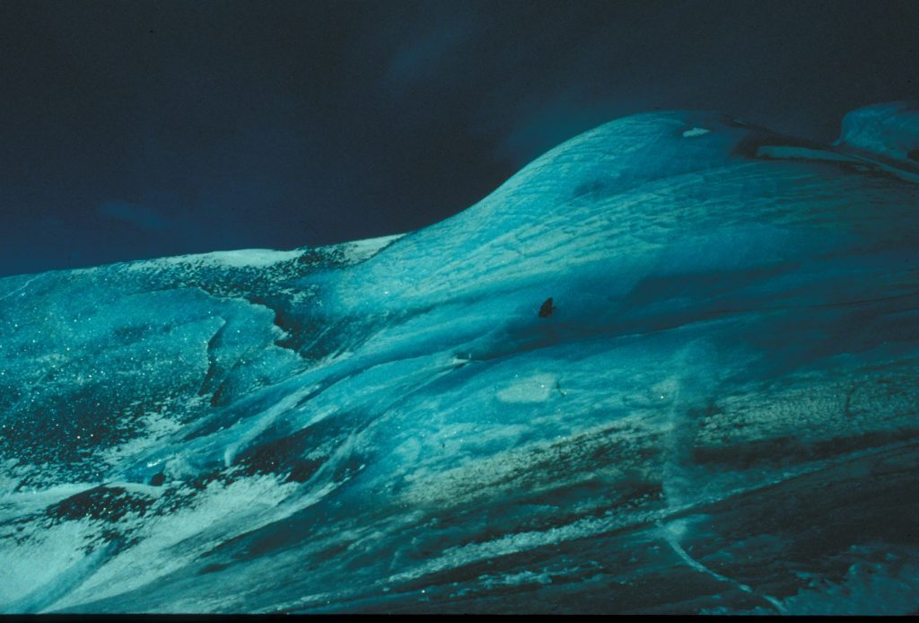 Researchers on top of a large composite iceberg in October 1996. Image Credit: Collin Roesler.