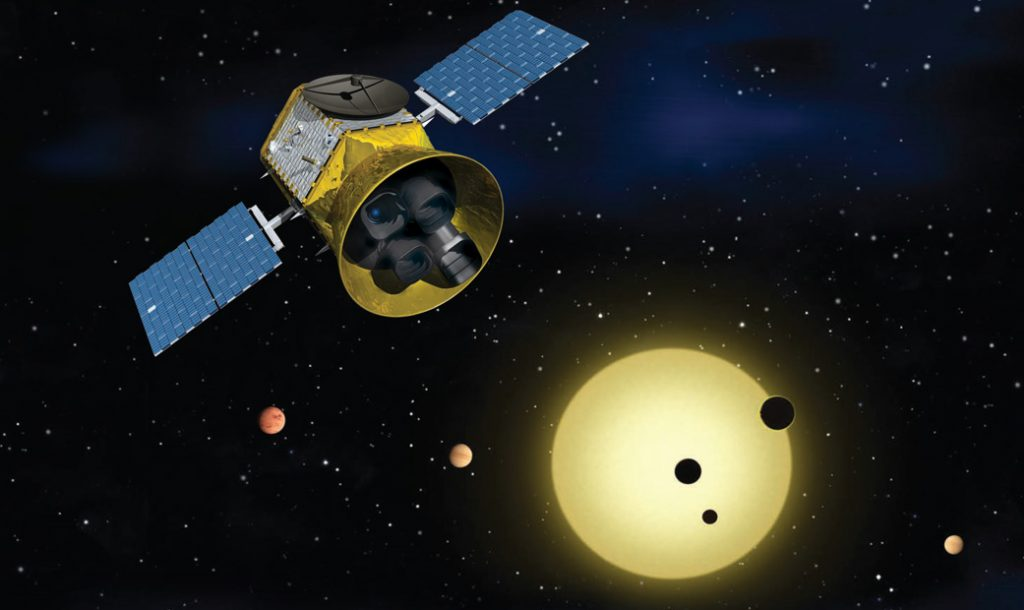 NASA's Transiting Exoplanet Survey Satellite (TESS), shown here in a conceptual illustration, will identify exoplanets orbiting the brightest stars just outside our solar system. Image Credit: NASA's Goddard Space Flight Center.
